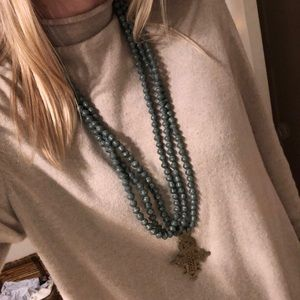 Green beaded cross necklace